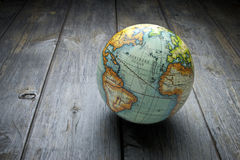 World Globe Wood Background. A world globe on a rustic wood background stock photo