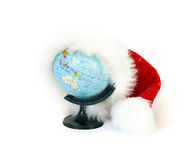 World globe and Santa Claus hat Stock Photo