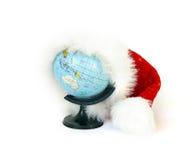World globe and Santa Claus hat stock photo
