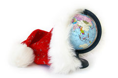 World globe and Santa Claus hat Royalty Free Stock Photography