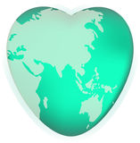 A world globe in the shape of a heart symbol. Concept for loving travel, or loving the world  Royalty Free Stock Photo