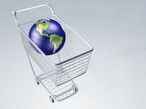 World globe in shopping cart Stock Image