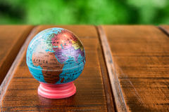 World globe standing on a desk Royalty Free Stock Photo