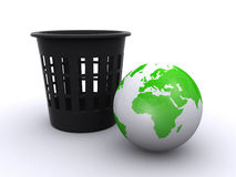 World globe and a trash can Stock Photos