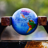 World globe in a vise Stock Photography