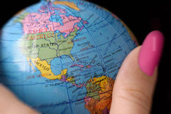 World globe in a woman's hand. This stock photo shows the world / globe in a woman's hand.  Can be used to illustrate many concepts such as business, politics or Royalty Free Stock Image