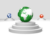 World globes on a pedestals. 3d green, blue and red world globes on a pedestals Royalty Free Stock Photo