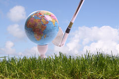 WORLD GOLF. Golfball in gras is going to hit by a golfclub Royalty Free Stock Photos