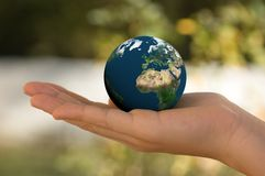 World in Hand. A hand holding the planet Earth Stock Images