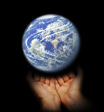 World in hand. The world in hand with black background stock images
