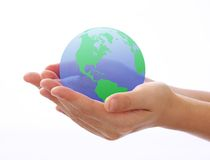World in hand. Concept photography -- world in hand -- blue sea and green land Royalty Free Stock Photo