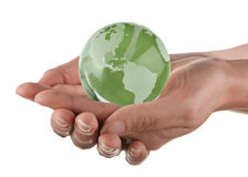 World in hand. Protecting the earth concept, globe in womans hands royalty free stock photo