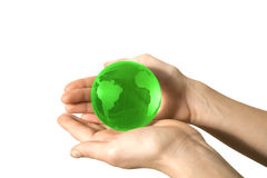 World in the hand. Male hand holding a green globe Stock Images