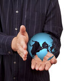 World in hand businessman. Stock Photo