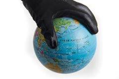 World in hand covered in oil Royalty Free Stock Photo
