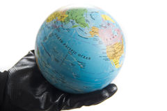 World in hand covered in oil Stock Photos