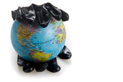 World in hand covered in oil Stock Photo