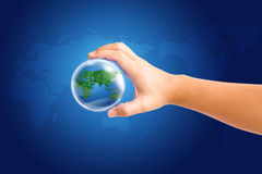 World in hand and global on blue map background. Save path world and hand for design work Stock Image