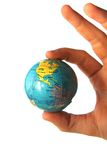 World In a hand of the person. A man holding a plastic globe in hand Royalty Free Stock Images