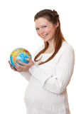 World is in the hands of pregnant girl. Stock Image