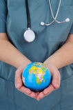 World Health. Female Doctor Holding A World Globe In Her Hands, Concept Of World Health Royalty Free Stock Photo