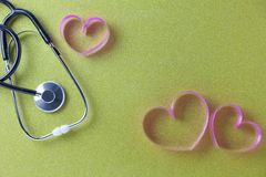 World health day background of Stethoscope with pink ribbon heart on beautiful colorful paper background,Healthcare and medical. Concept stock photo
