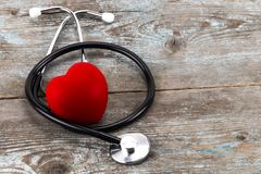 World health day campaign with red love heart and medical docto. R`s stethoscope, first aid concept stock photography