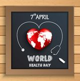 World health day concept with globe inside heart on blackboard on wooden table Royalty Free Stock Photo