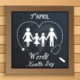 World health day concept with healthy family under stethoscope on blackboard on wooden table Stock Image