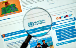 World Health Organisation logo and web site. MONTREAL, CANADA - MARCH 8, 2016 - World Health Organisation logo and web site under magnifying glass. The World royalty free stock image