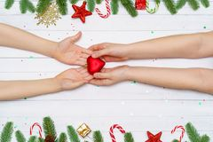 World heart day, christmas concept. Children hand with red heart royalty free stock photo