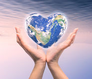 World in heart shape with over women human hands Royalty Free Stock Photography