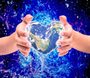 World in heart shape with over women human hands Stock Photography
