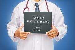World Hepatitis day concept. STOP HEPATITIS on chalkboard in doctor hand. World Hepatitis day concept Stock Photo
