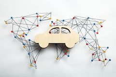World infrastructure map and wooden car figure royalty free stock photo