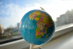 The world inside. Picture of a globe by the window Royalty Free Stock Photography