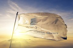 World Intellectual Property Organization WIPO flag textile cloth fabric waving on the top sunrise mist fog. Beautiful stock photos