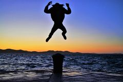 World jump sunset stock images