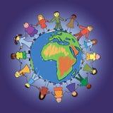 World kids. Multiethnic kids on top of a globe Royalty Free Stock Image