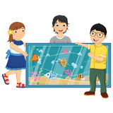 Vector Illustration Of Kids Watching Fishes in an. Aquarium Stock Photos