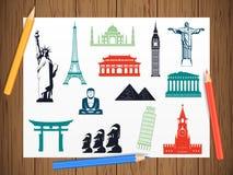 World landmarks icons on paper in work progress. Landmarks icons set. Vector Stock Photos