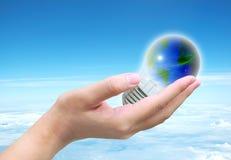 World in light bulb Stock Photos
