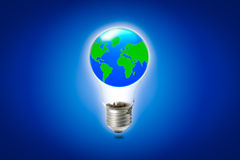 World in light bulb. World in light bulb on blue background Stock Photography