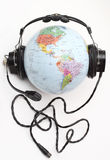 World is listening. Globe with headphones (Names in Russian), listening to music Stock Photography
