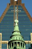 World Locations. Church steeple in front of skyscraper in ,Montreal, Quebec, Canada Royalty Free Stock Images