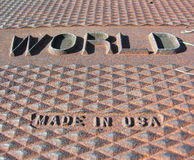 World, made in USA. Manhole cover with WORLD, MADE IN USA on it stock photography