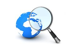 World and magnifier Stock Photos