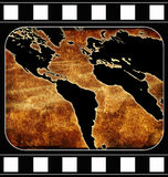 World map. Computer designed film framed grunge world map background Royalty Free Stock Photography