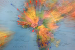 World Map. With some red and blue pins coming from some Africa s country Stock Image