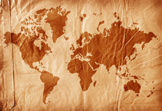 World map on aged paper Stock Images